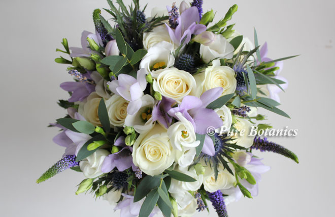 English country style posy bouquet featuring ivory roses, lilac freesias and lavender.