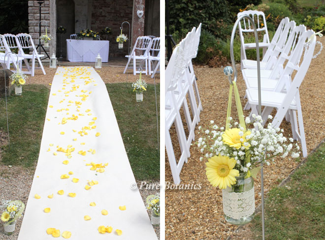 An outdoor spring wedding ceremony with a yellow flower theme.