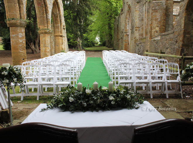 Outdoor wedding ceremony at Ettington Park Hotel near Stratford Upon Avon.