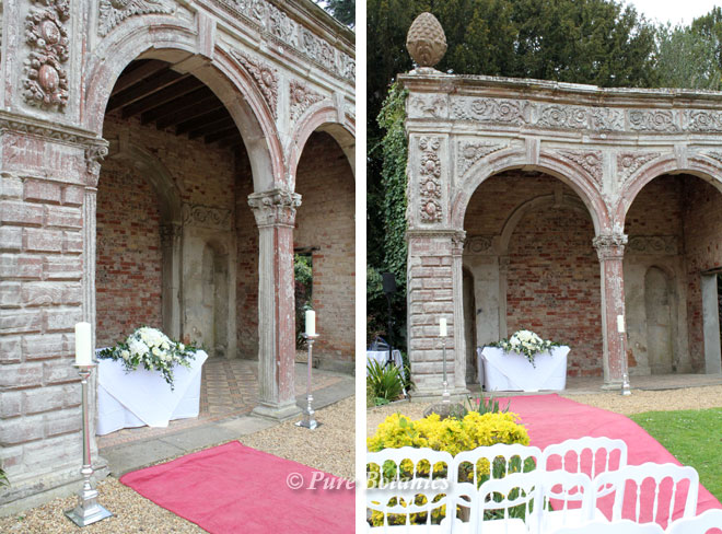 Outside wedding ceremony flowers in the Orangery at Ettington Park.