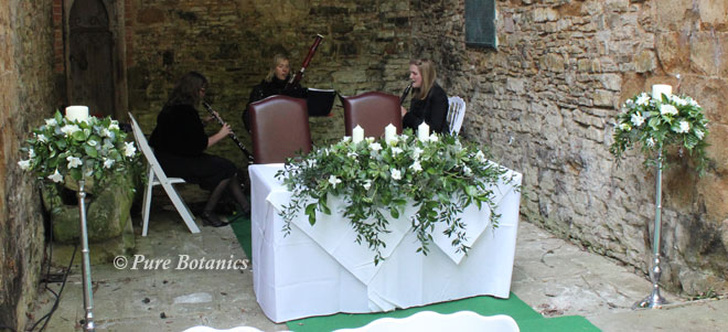 The orchestra set up in the chapel at Ettington Park for an outdoor wedding ceremony.