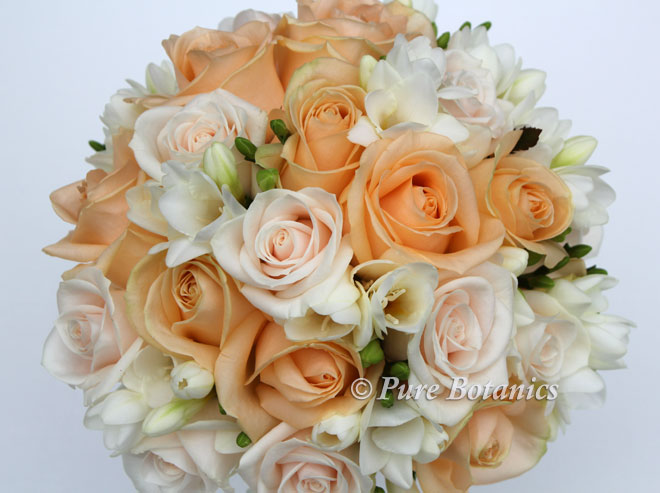 Peach and cream handtied rose bridal bouquet.