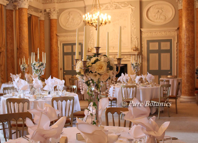 Candelabra's decorated with ivory wedding flowers and pearls, Warwickshire.