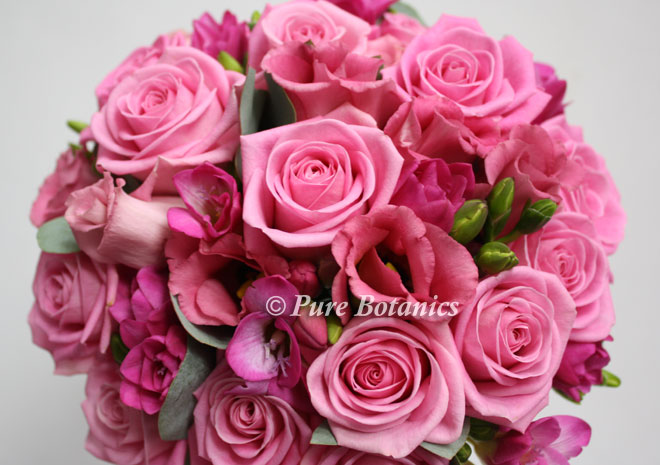 Pink rose and lisianthus posy bouquet.