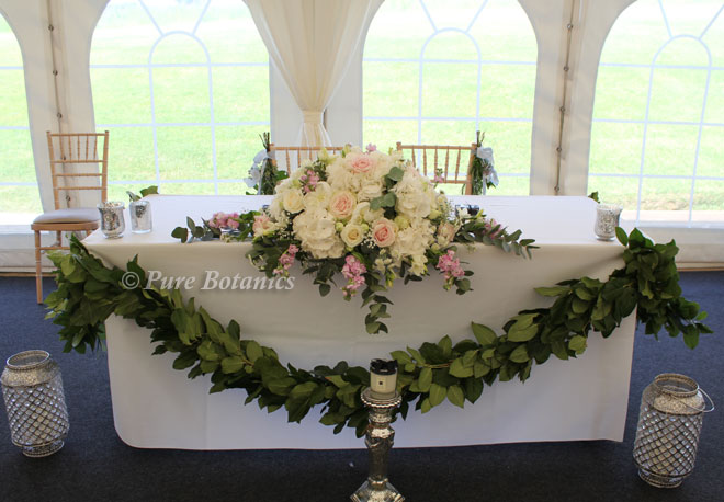 Top table flowers in the marquee at Wethele Manor, Leamington Spa.