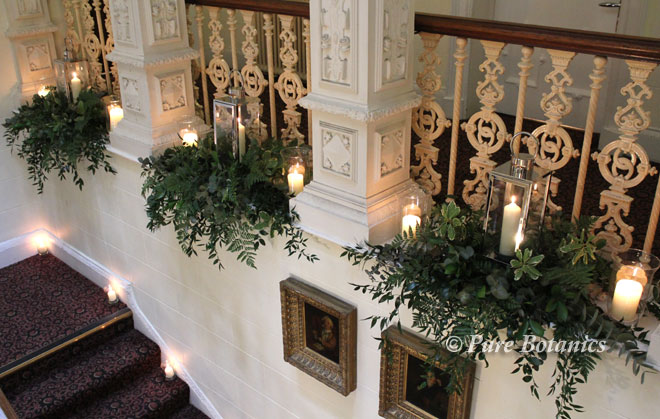 Wedding candle flowers at Ettington Park on the staircase.
