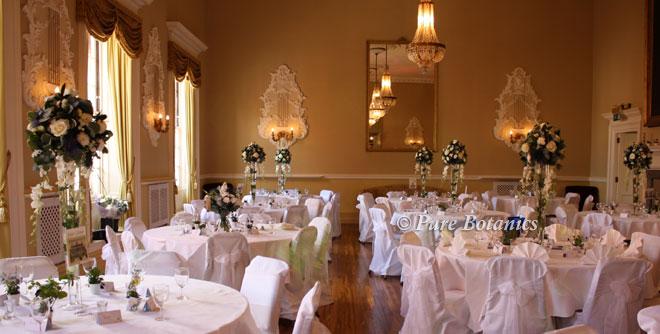 Tall wedding centrepieces in Stratford Town Hall, Warwickshire.