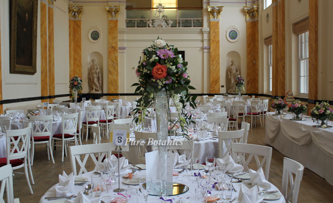 Tall wedding centre pieces in Leamington Spa pump rooms.
