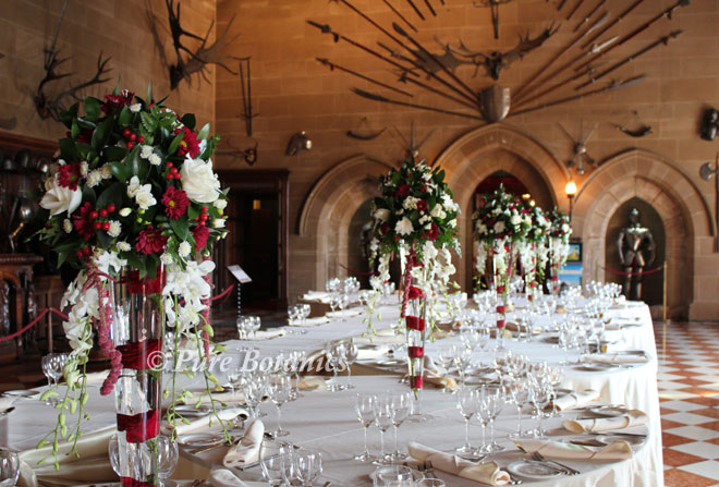 Red and ivory rose wedding centrepieces at Warwick Castle.