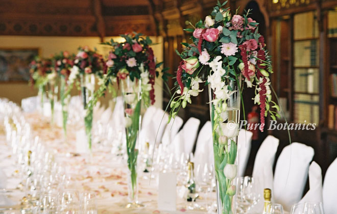 Wedding table flowers in the long gallery at Ettington Park Hotel