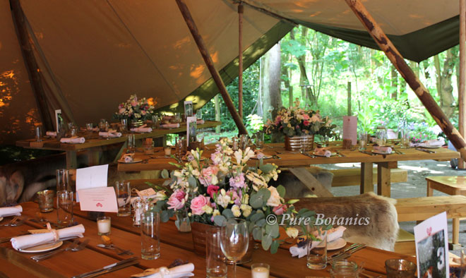 Natural country wedding flowers for a teepee wedding.