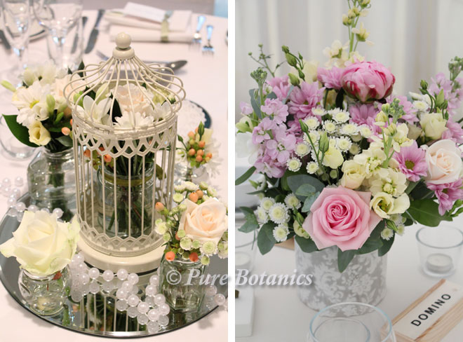 Vintage centrepieces featuring roses and stocks.