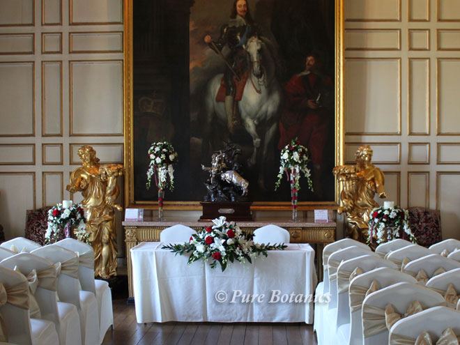 Flowers set up for a civil ceremony in the state dining room at Warwick Castle.