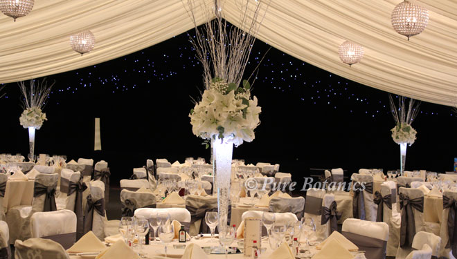 Dramatic lily centrepieces with underwater lights at Coombe Abbey