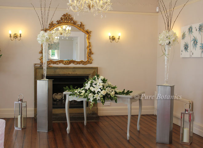 White lily wedding ceremony flowers at Ashton Lodge.
