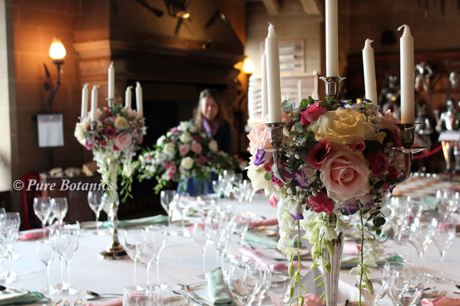 Setting up our candleabra wedding flowers at Warick Castle.