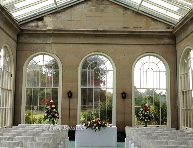 Setting up the orangery at Stoneleigh Abbey for a civil wedding ceremony.