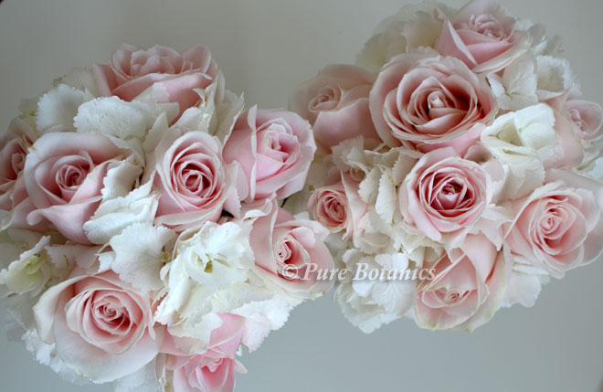 White hydrangea and pale pink rose bridesmaids bouquets, Warwickshire.