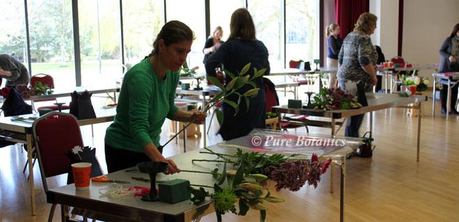 Preparing flowers at the floristry workshop.