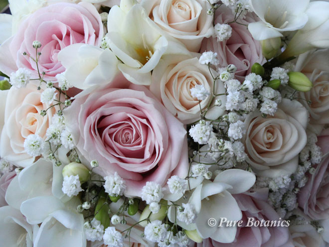 Vintage style posy bouquet in pastel colours.