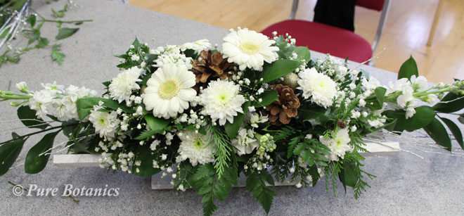 Gerbera's, gypsophila and stocks in a Christmas table centrepiece.