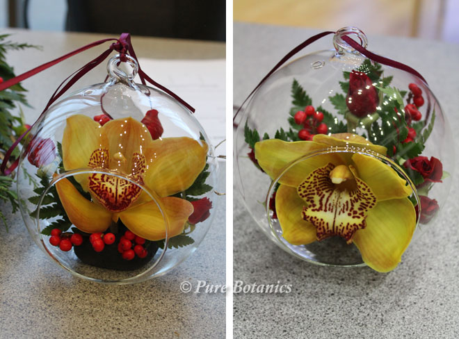 Glass baubles with fresh flower decorations.
