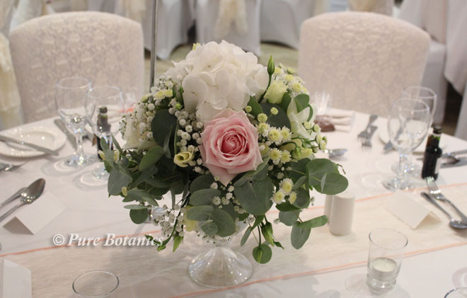 Hydrangea, rose and gypsophila low wedding centrepiece.