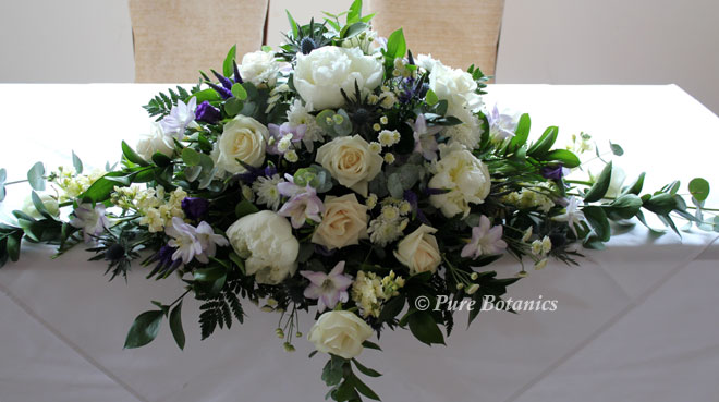 Top table arrangement used on the registrars table for the wedding ceremony.