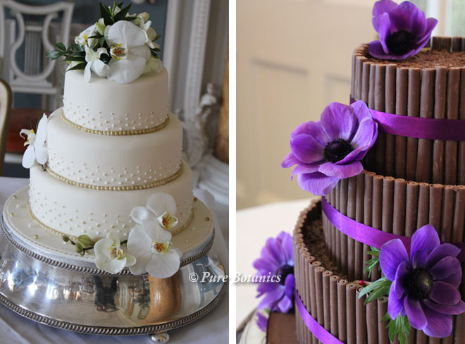 Flowers placed on the tiers of the wedding cake.
