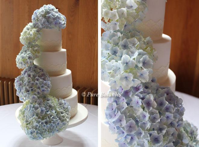 Blue hydrangeas cascading down a wedding cake.