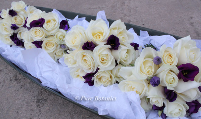 Ivory rose handtied posy bouquets for a Christmas wedding at Ettington Park.