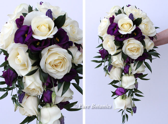 Ivory roses and purple lisianthus shower bouquet for a Christmas wedding.