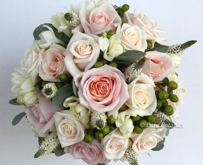 blush pink and cream rose bouquet with natural berries foliage and veronica.