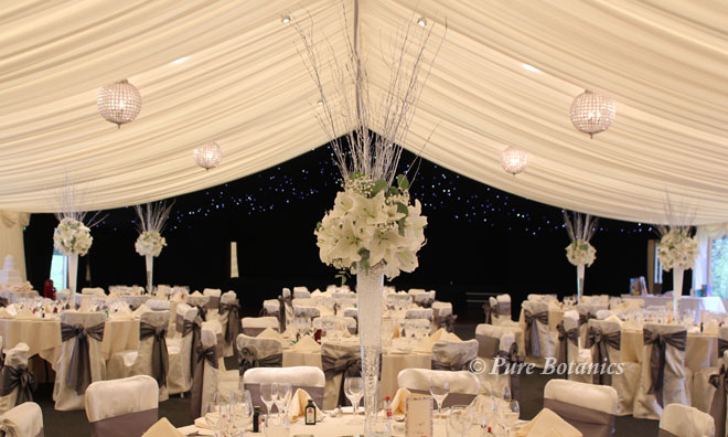 Sliver twigs and underwater lights to give the wedding centrepieces sparkle.