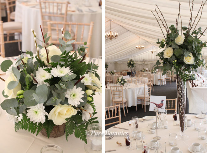 Tall and low wedding centrepieces for a woodland themed wedding at Wethele Manor.