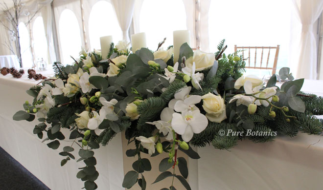 A winter woodland wedding flower arrangement.
