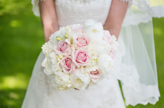 Blush pink roses and white peonies for a spring wedding.