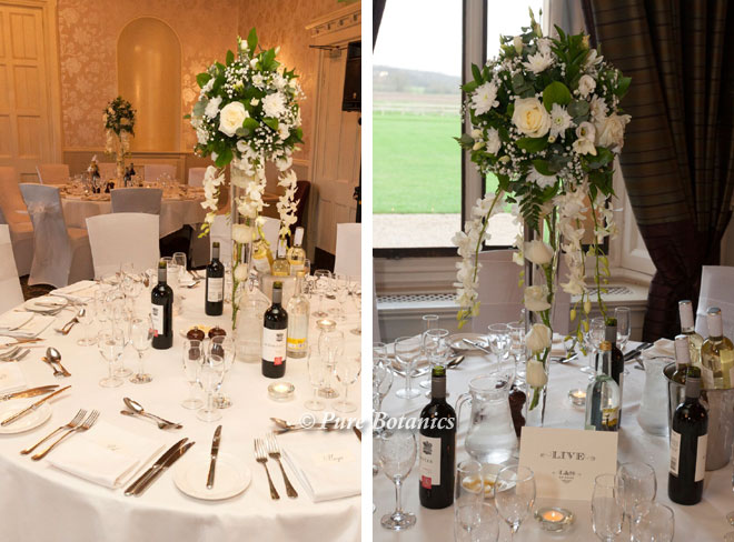 Tall wedding centrepieces in the Moncreif at Walton Hall Warwickshire.