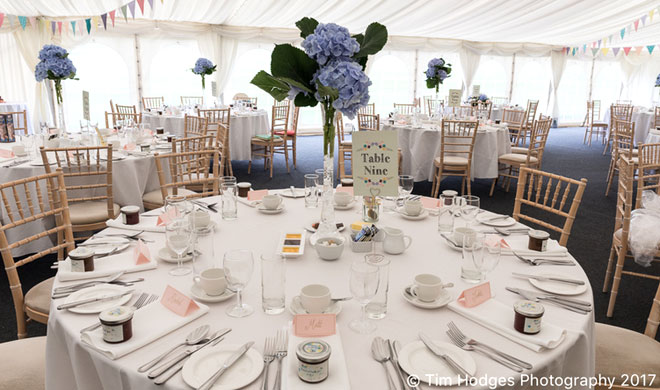 Tall pale blue hydrangea wedding centrepieces at Wethele Manor, Warwickshire.
