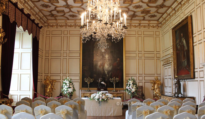 Pedestal arrangements in the State Dinning room for a wedding ceremony at Warwick Castle.
