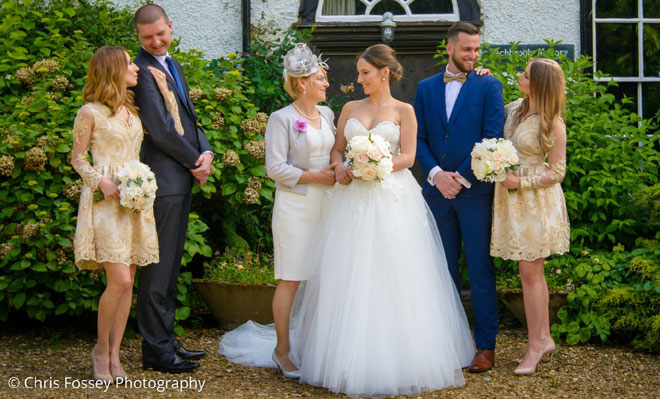 Bridal party photographed with their wedding bouquets in Leamington Spa.