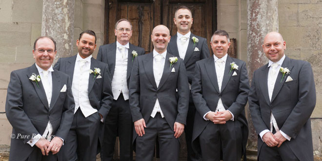 Groomsman wearing gypsophila and freesia buttonholes for a winter wedding.