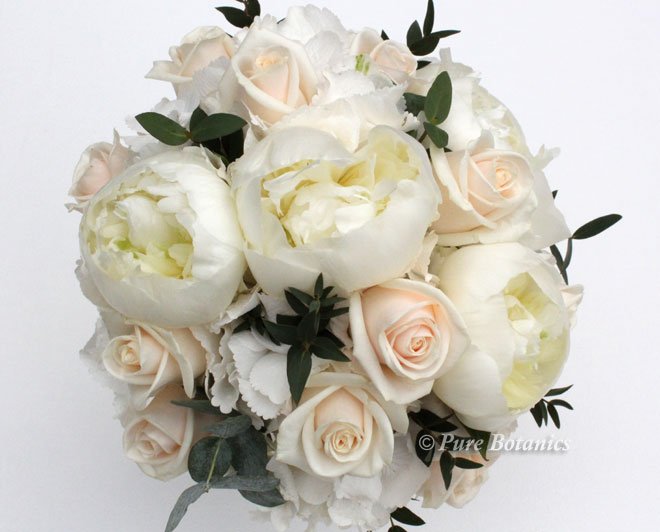 Cream Vendela roses and white peonies in a bridesmaids posy bouquet.