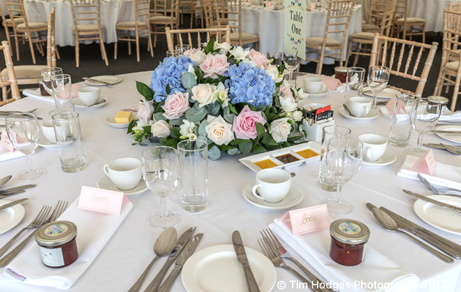 A vintage style round top table arrangement for the wedding breakfast.