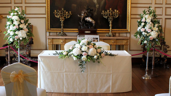 Blush pink and cream civil ceremony flower decorations at Warwick Castle.