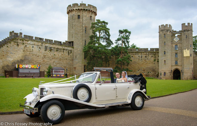 Bride and Groom in their wedding car at Warwick Castle.