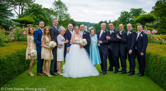 Bridal party photographed in the grounds at the Castle, Warwickshire.