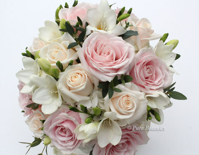 Handtied posy bridal bouquet in cream and blush pink.