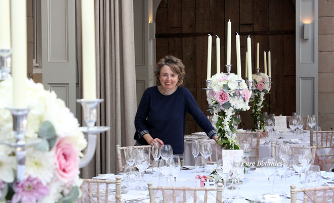 Setting up candelabra wedding centrepieces at Hampton Manor, Solihull.