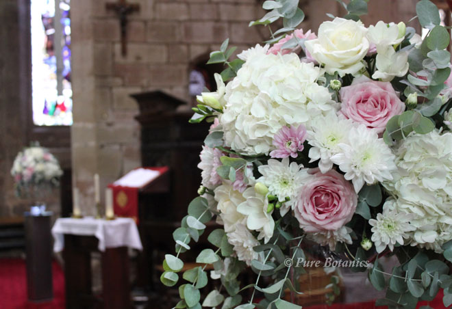 Blush pink and ivory church wedding pedestal decorations.